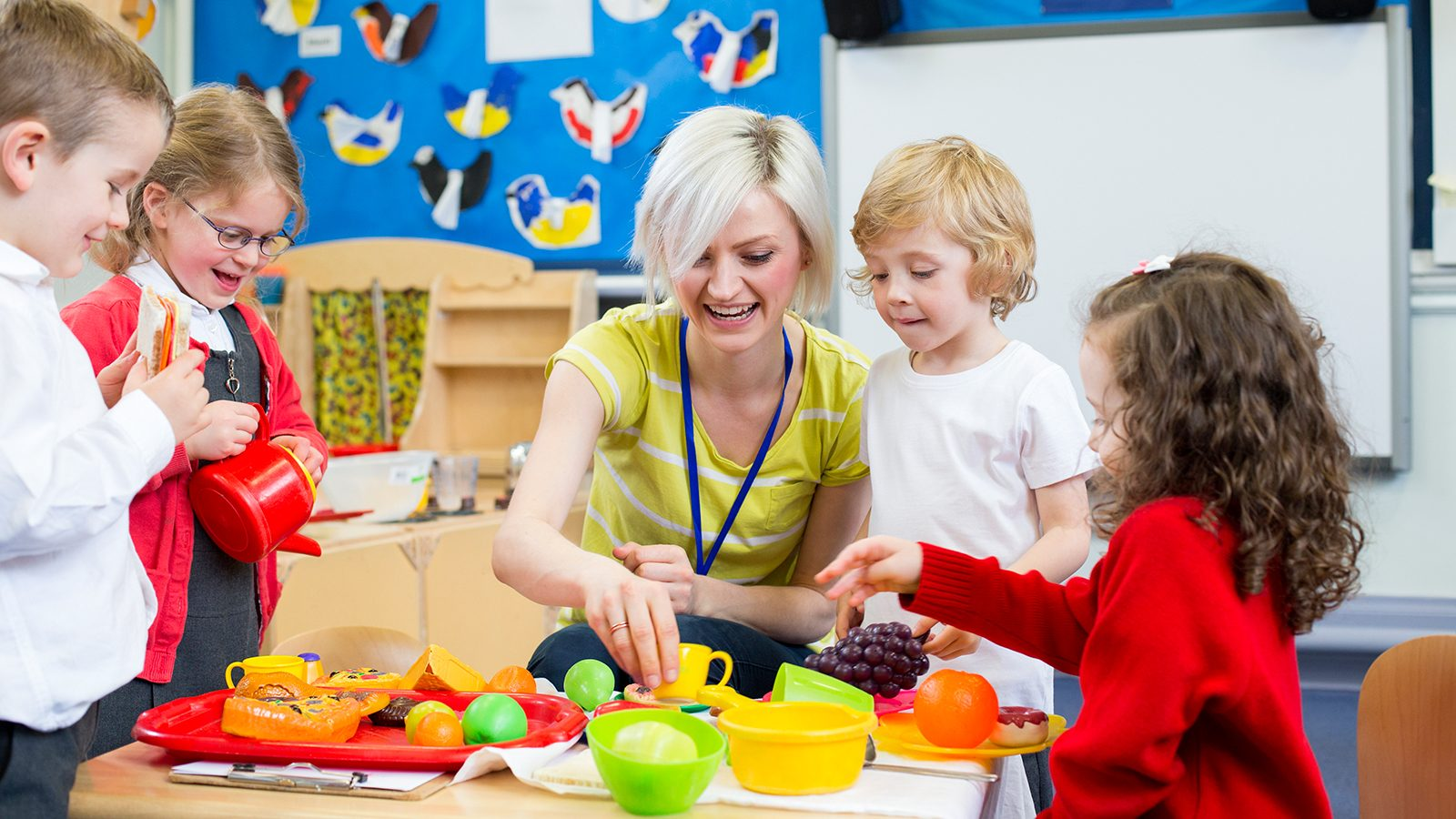 Experienced nursery teachers and staff with nursery children